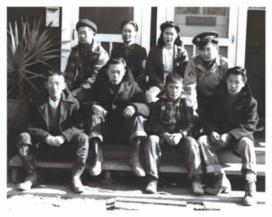 "The only Tanouye family photograph of known existence. Taken while Ted was on leave and visiting his family who were incarcerated. Front Row l to r: Nikuma (father), Harumi ""Harm"", Yukiwo ""Yuki"", Kiyoyuki ""Bill"" Back Row l to r: Isao ""Easy"", Momoe (mother), Sumiye ""Sumi"", Takayuki ""Ted"" Photo provided courtesy of the Tanouye Family"