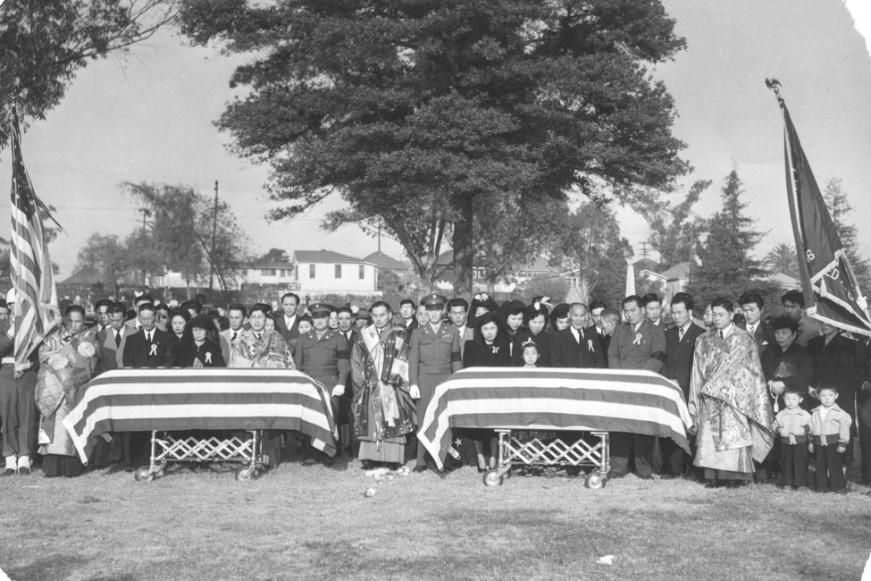 Shimatsu/Tanouye burial service at Evergreen Cemetery in Los Angeles, California. Evergreen was one of the few that would accept Japanese Americans during WWII (and shortly after), in the Los Angeles area. The friends are buried side-by-side. Photo provided courtesy of the Shimatsu and Tanouye Families. Photographed by Toyo Miyatake