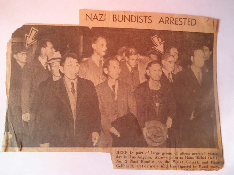 This was how arrest was reported in Los Angeles Examiner. The headline is misleading because the majority of the people inn the picture were not in any way linked to the Nazi Bundists. Fritz Caspari, in the center right of photo holding his arm to his head, was firmly opposed to the Nazi regime.